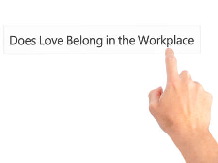 does: Does Love Belong in the Workplace? - Hand pressing a button on blurred background concept . Business, technology, internet concept. Stock Photo