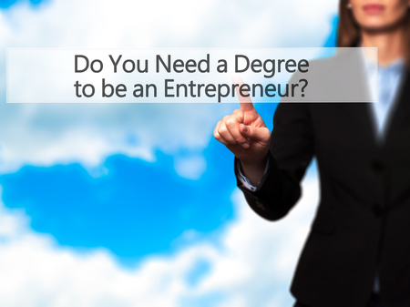 executive courses: Do You Need a Degree to be an Entrepreneur ? - Businesswoman pressing high tech  modern button on a virtual background. Business, technology, internet concept. Stock Photo Stock Photo