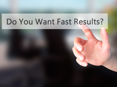 rewarding: Do You Want Fast Results ? - Hand pressing a button on blurred background concept . Business, technology, internet concept. Stock Photo