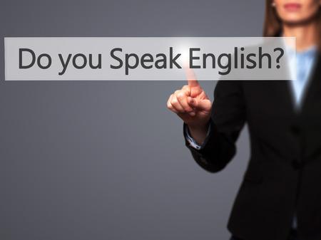 fluent: Do you Speak English ? - Businesswoman pressing high tech  modern button on a virtual background. Business, technology, internet concept. Stock Photo