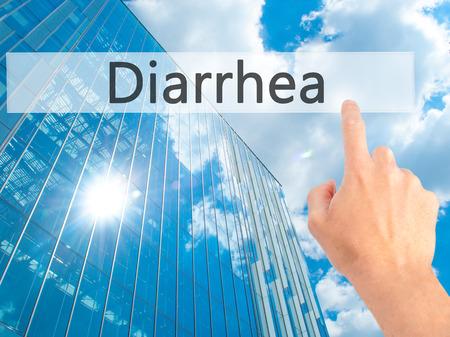 diarrea: Diarrhea - Hand pressing a button on blurred background concept . Business, technology, internet concept. Stock Photo Foto de archivo