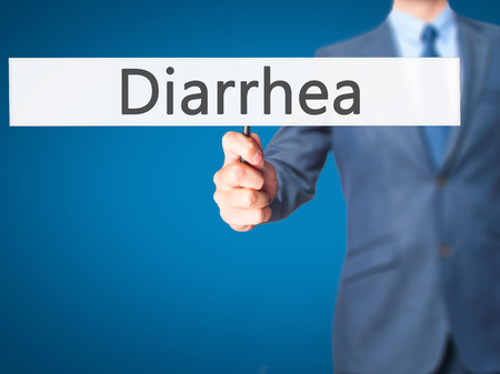 gastroenteritis: Diarrhea - Businessman hand holding sign. Business, technology, internet concept. Stock Photo