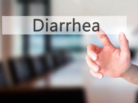 gastroenteritis: Diarrhea - Hand pressing a button on blurred background concept . Business, technology, internet concept. Stock Photo Stock Photo