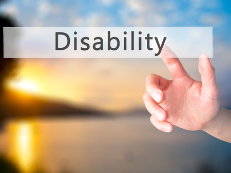 helplessness: Disability - Hand pressing a button on blurred background concept . Business, technology, internet concept. Stock Photo Stock Photo