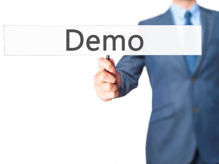 demo: Demo - Businessman hand holding sign. Business, technology, internet concept. Stock Photo Stock Photo
