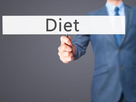nutricion: Diet - Businessman hand holding sign. Business, technology, internet concept. Stock Photo