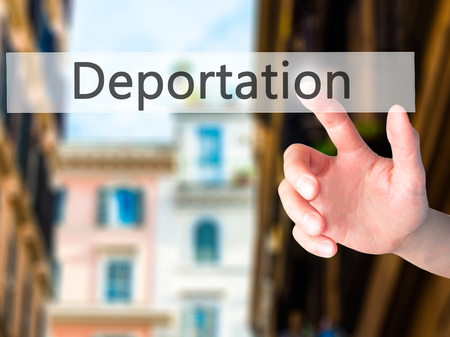 naturalization: Deportation - Hand pressing a button on blurred background concept . Business, technology, internet concept. Stock Photo Stock Photo