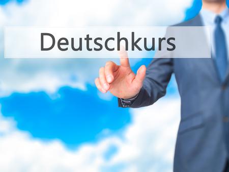 naturalization: Deutschkurs (German Course in German) - Businessman hand pushing button on touch screen. Business, technology, internet concept. Stock Image