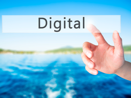 marketers: Digital - Hand pressing a button on blurred background concept . Business, technology, internet concept. Stock Photo