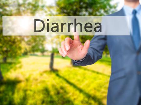 diarrea: Diarrea - La mano de negocios presionando el bot�n en la pantalla t�ctil. Negocios, la tecnolog�a, el concepto de internet. imagen de archivo