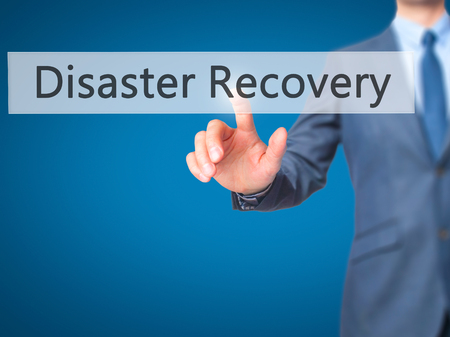 pushing button: Disaster Recovery - Businessman hand pushing button on touch screen. Business, technology, internet concept. Stock Image Stock Photo