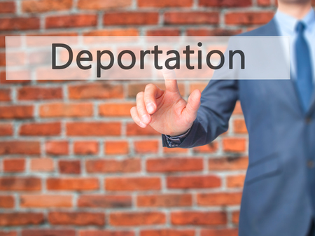 deportation: Deportation - Businessman hand pushing button on touch screen. Business, technology, internet concept. Stock Image Stock Photo