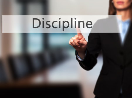 Discipline - Business woman point finger on push touch screen and pressing digital virtual button. Business, technology, internet concept. Stock Photo