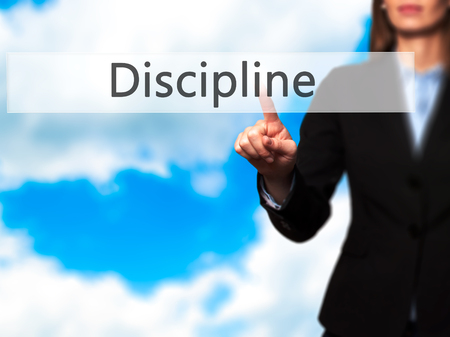 disciplined: Discipline - Business woman point finger on push touch screen and pressing digital virtual button. Business, technology, internet concept. Stock Photo