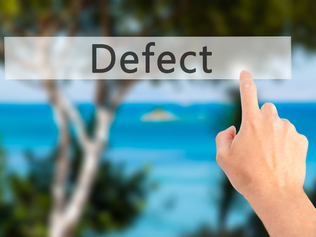 defect: Defect - Hand pressing a button on blurred background concept . Business, technology, internet concept. Stock Photo