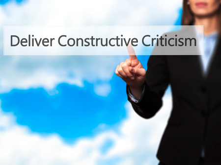 criticism: Deliver Constructive Criticism - Business woman point finger on push touch screen and pressing digital virtual button. Business, technology, internet concept. Stock Photo