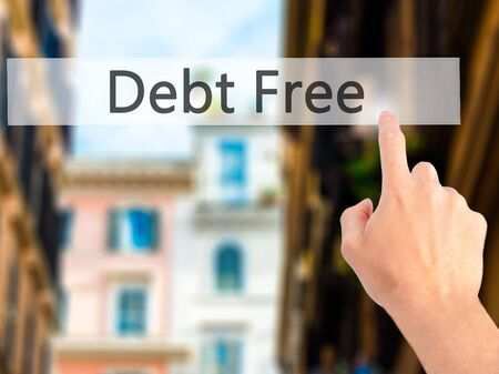bank records: Debt Free - Hand pressing a button on blurred background concept . Business, technology, internet concept. Stock Photo Stock Photo