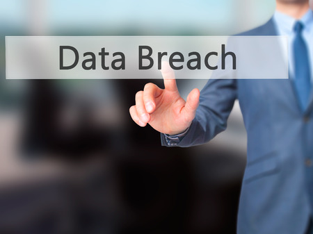 backdoor: Data Breach - Businessman hand pushing button on touch screen. Business, technology, internet concept. Stock Image Stock Photo