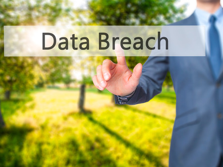 pushing button: Data Breach - Businessman hand pushing button on touch screen. Business, technology, internet concept. Stock Image Stock Photo