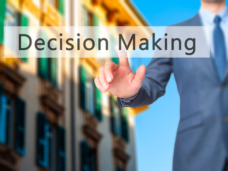 pushing button: Decision Making - Businessman hand pushing button on touch screen. Business, technology, internet concept. Stock Image