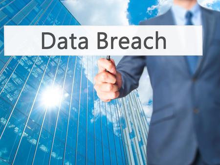 Data Breach - Businessman hand holding sign. Business, technology, internet concept. Stock Photo