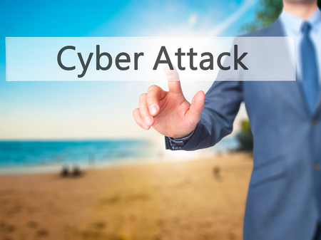 cyber war: Cyber Attack - Businessman hand pushing button on touch screen. Business, technology, internet concept. Stock Image Stock Photo