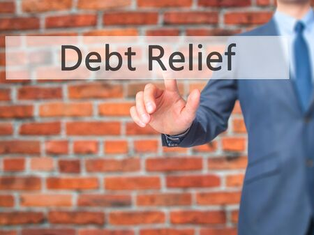 stock image: Debt Relief - Businessman hand pushing button on touch screen. Business, technology, internet concept. Stock Image Stock Photo