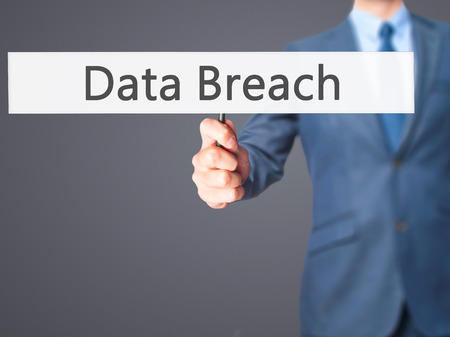 backdoor: Data Breach - Businessman hand holding sign. Business, technology, internet concept. Stock Photo Stock Photo