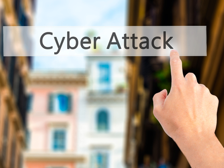 inconvenience: Cyber Attack - Hand pressing a button on blurred background concept . Business, technology, internet concept. Stock Photo
