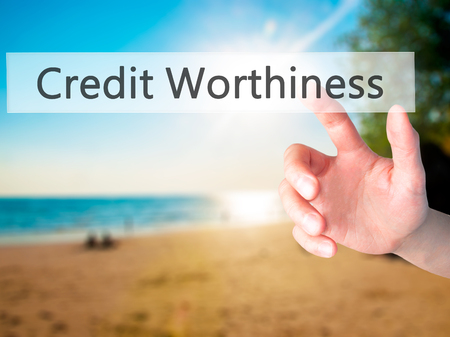 creditworthiness: Credit Worthiness - Hand pressing a button on blurred background concept . Business, technology, internet concept. Stock Photo