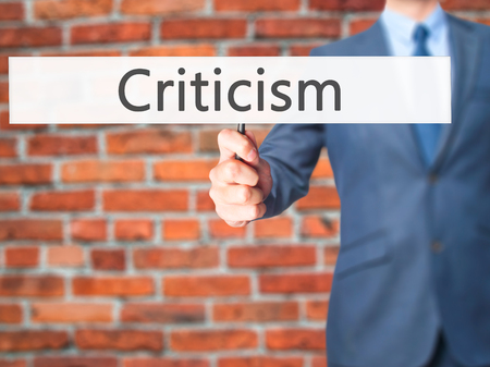 criticism: Criticism - Business man showing sign. Business, technology, internet concept. Stock Photo