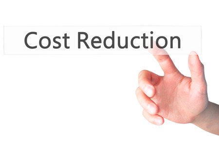 deficit target: Cost Reduction - Hand pressing a button on blurred background concept . Business, technology, internet concept. Stock Photo Stock Photo