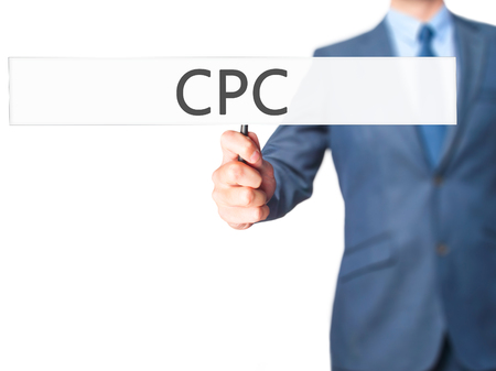 cpc: CPC - Business man showing sign. Business, technology, internet concept. Stock Photo