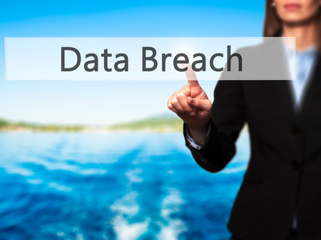 incursion: Data Breach -  Female touching virtual button. Business, internet concept. Stock Photo
