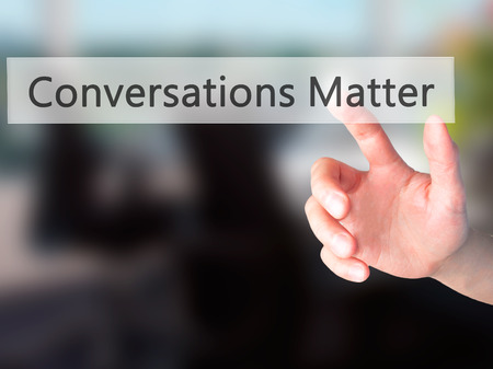 Conversations Matter - Hand pressing a button on blurred background concept . Business, technology, internet concept. Stock Photo Imagens
