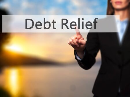 trouble free: Debt Relief -  Female touching virtual button. Business, internet concept. Stock Photo