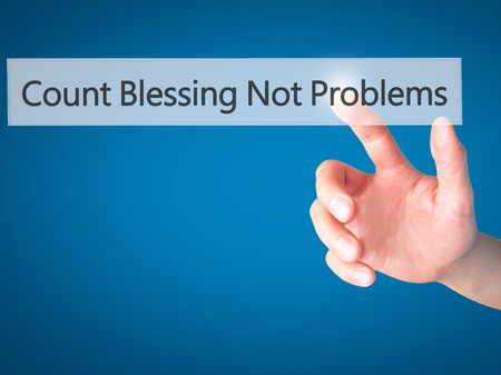 universal love: Count Blessing Not Problems - Hand pressing a button on blurred background concept . Business, technology, internet concept. Stock Photo