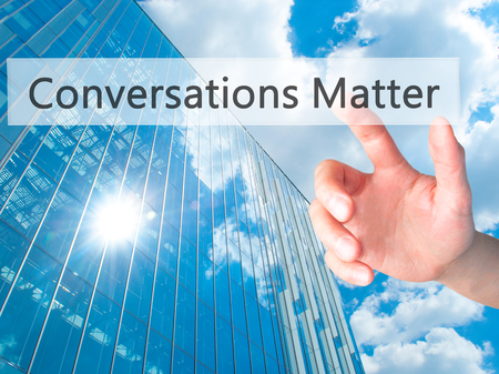 business matter: Conversations Matter - Hand pressing a button on blurred background concept . Business, technology, internet concept. Stock Photo Stock Photo