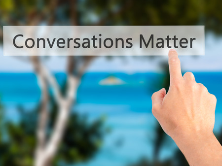 matter: Conversations Matter - Hand pressing a button on blurred background concept . Business, technology, internet concept. Stock Photo Stock Photo