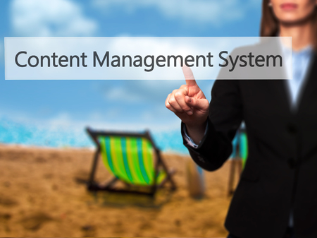 ecm: Content Management System -  Successful businesswoman making use of innovative technologies and finger pressing button. Business, future and technology concept. Stock Photo Stock Photo