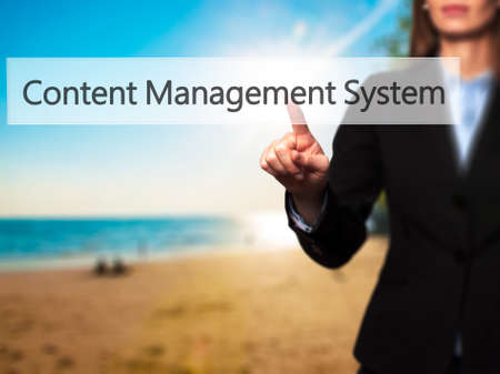 Content Management System -  Successful businesswoman making use of innovative technologies and finger pressing button. Business, future and technology concept. Stock Photo Stock Photo