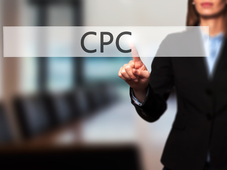 cpc: CPC -  Successful businesswoman making use of innovative technologies and finger pressing button. Business, future and technology concept. Stock Photo Stock Photo
