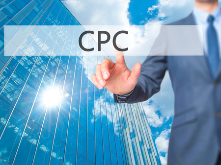 cpc: CPC - Businessman hand touch  button on virtual  screen interface. Business, technology concept. Stock Photo