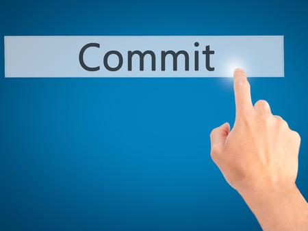 comité d entreprise: Commit - Hand pressing a button on blurred background concept . Business, technology, internet concept. Stock Photo