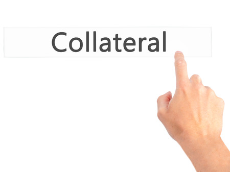 collateral: Collateral - Hand pressing a button on blurred background concept . Business, technology, internet concept. Stock Photo