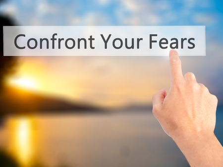 confront: Confront Your Fears - Hand pressing a button on blurred background concept . Business, technology, internet concept. Stock Photo Stock Photo