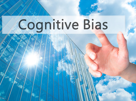 cognitive: Cognitive Bias - Hand pressing a button on blurred background concept . Business, technology, internet concept. Stock Photo Stock Photo