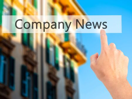 urgent announcement: Company News - Hand pressing a button on blurred background concept . Business, technology, internet concept. Stock Photo