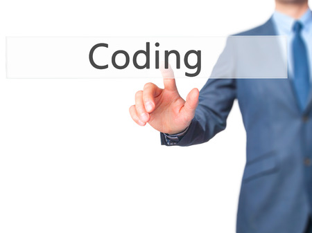 programer: Coding - Businessman click on virtual touchscreen. Business and IT concept. Stock Photo Stock Photo