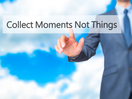 cobrar: Collect Moments Not Things - Businessman click on virtual touchscreen. Business and IT concept. Stock Photo